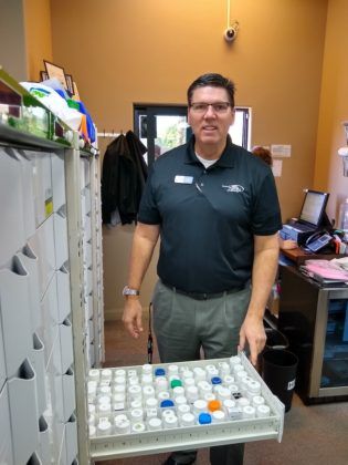 Cliff Holt, R.Ph., above, has built the growth at Hurricane Family Pharmacy around his PioneerRx pharmacy system, which inte- grates well with his automation and manages his med sync program.