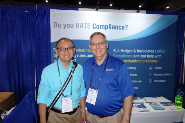 National Community Pharmacists Association 2019 Conference and Trade Show Exhibits Phil Ho, left, from the AIDS Healthcare Foundation with R.J. Hedges & Associates' Jeff Hedges