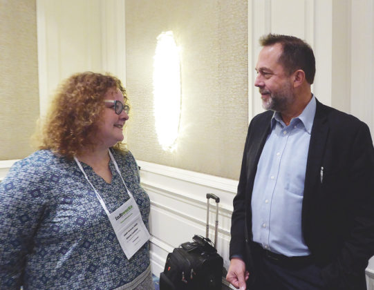 Alecia Lashier, VP, solutions engineering at Innovation Associates, talks with David Lang, business manager, pharmacy products Avery Weigh-Tronix.