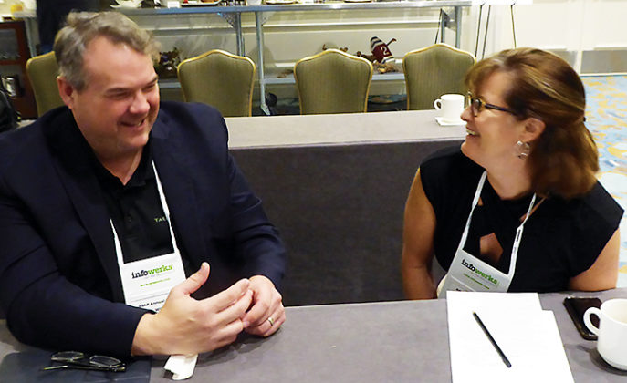 Tom Wilson, chief technology innovation officer, Tabula Rasa HealthCare, and Sara Salton, product manager, CarePoint, chat during a break in the presentations.